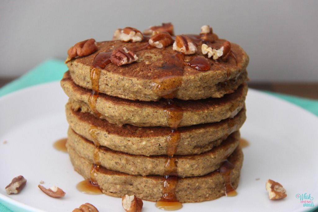 Butternut Squash Pancakes topped with maple syrup and raw pecans