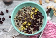 Cranberry Pistachio Quinoa Breakfast Bowl with chopped Maca Chocolate