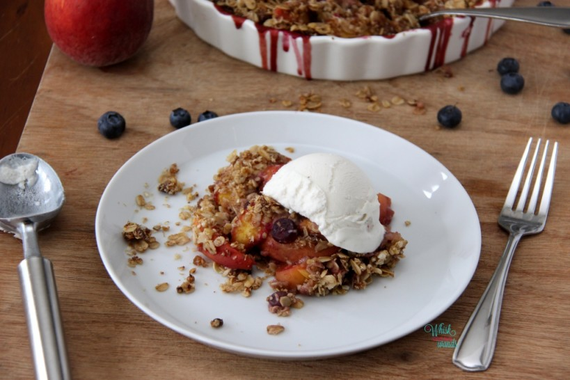 Peach Blueberry Crumble topped with So Delicious Vanilla Bean Coconut Milk Ice Cream