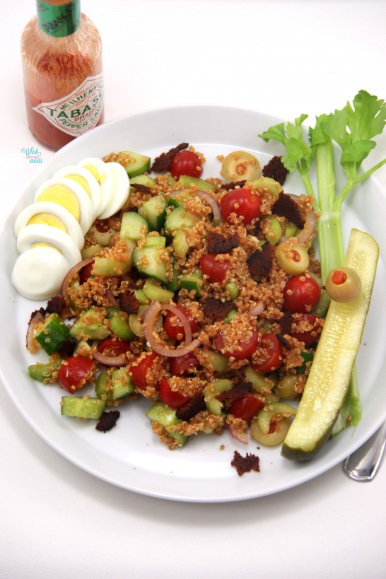 His Bloody Mary Quinoa Salad with chopped vegan bacon and egg