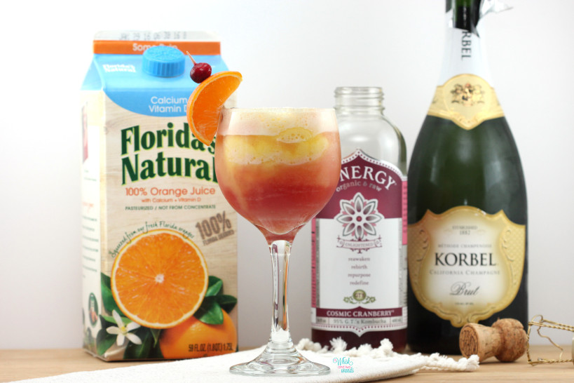 Part pineapple orange smoothie, part Cosmic Cranberry Kombucha, and champagne.... a delicious New Years Day Mimosa!