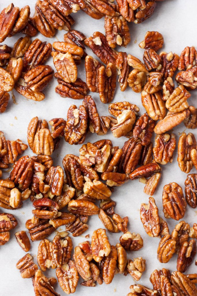 Simply delicious Candied Maple Pecans are pecans coated with a sweet chewy maple coating. Gluten free and vegan these nuts are a healthy treat and addicting!