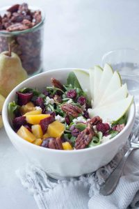 Delicious seasonal Beet, Pear, and Maple Pecan Salad is packed with flavor, texture, and nutrtion. Great for a quick and easy weeknight dinner or impress dinner guests or serve at a get together. Gluten free and vegan friendly.