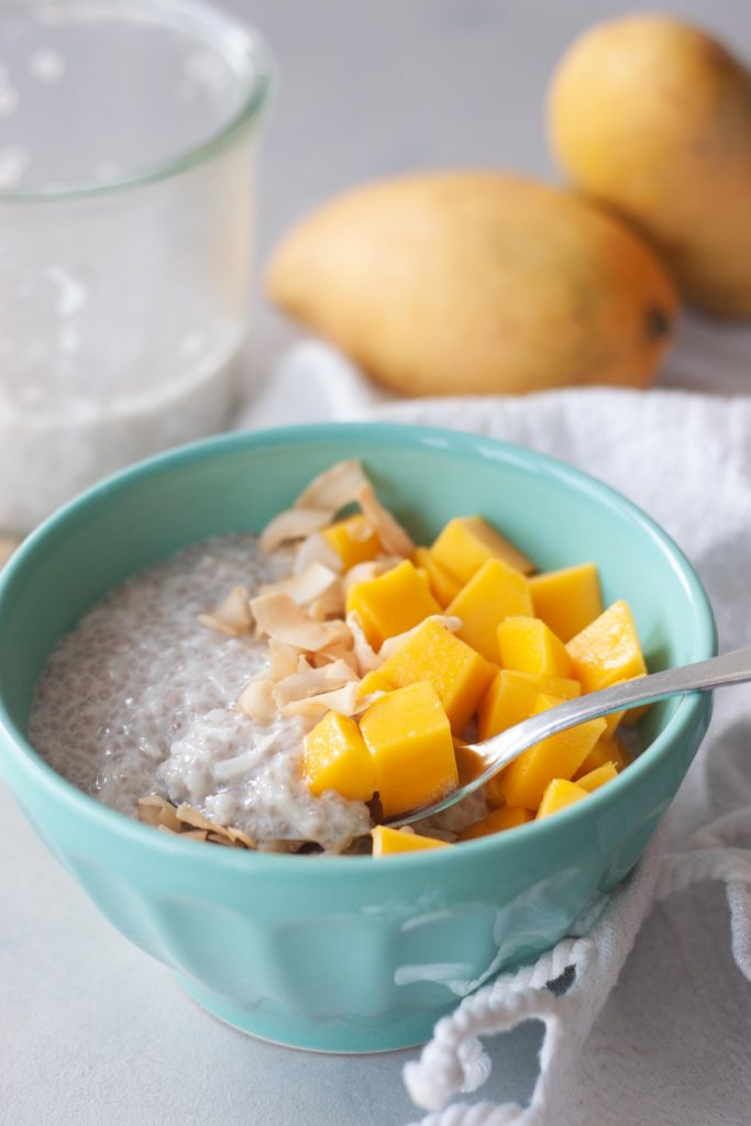 Mango Coconut Chia Rice Pudding with spoon