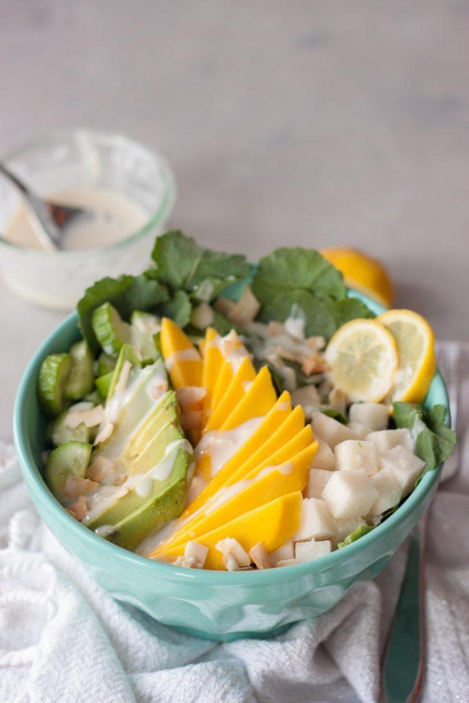 Tropical Mango Avocado Kale Salad in bowl