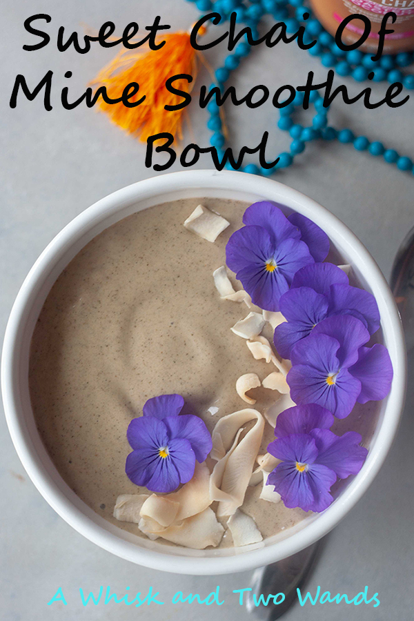 Sweet Chai Of Mine Smoothie Bowl with edible flowers and coconut