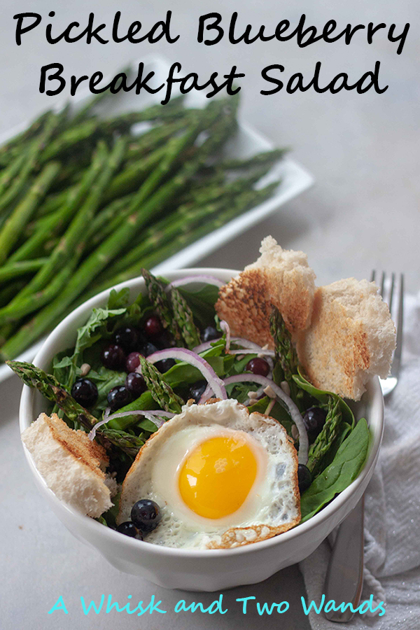 Flavor and nutrition packed with Pickled Blueberry Breakfast Salad is greens, grilled asparagus, pickled blueberries, onion, sunflower seeds topped with optional sourdough toaster croutons and an egg! Perfect for breakfast as well as lunch or dinner!