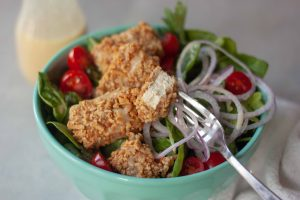 Inside of Pretzel Crusted Tofu on a salad