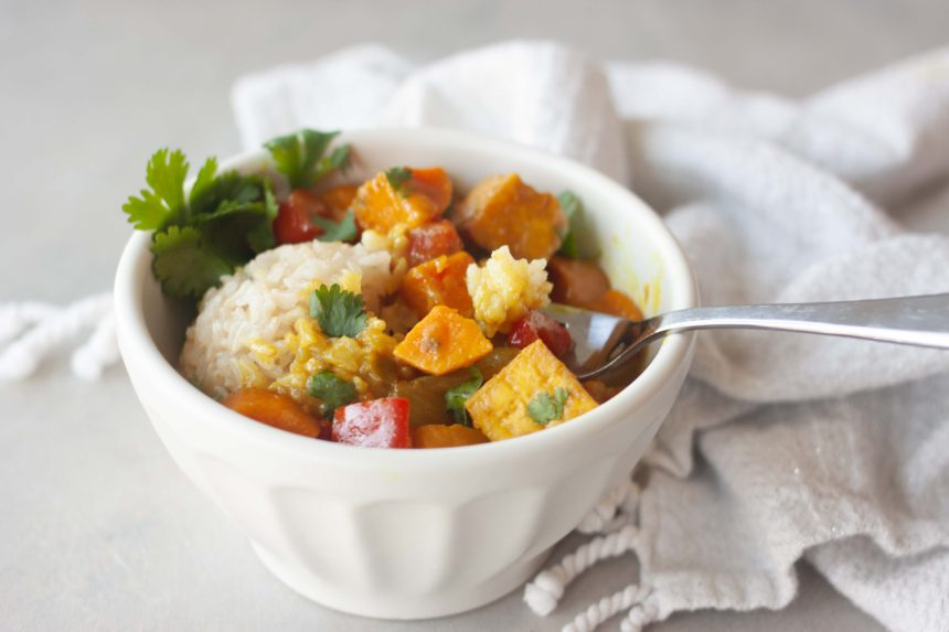 Bowl with fork of Sweet Potato Yellow Curry