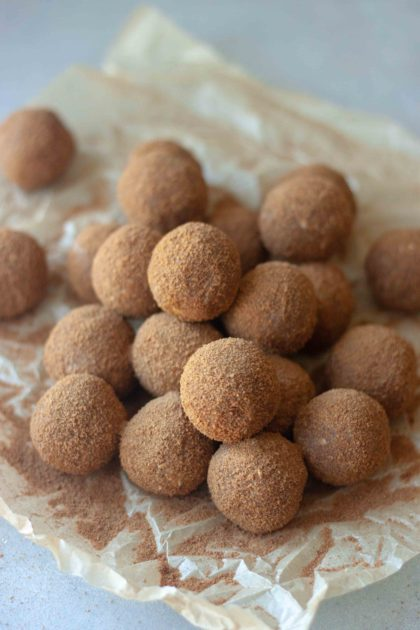 Pile of Cinnamon Sweet Potato No Bake Donut Holes and cinnamon sugar