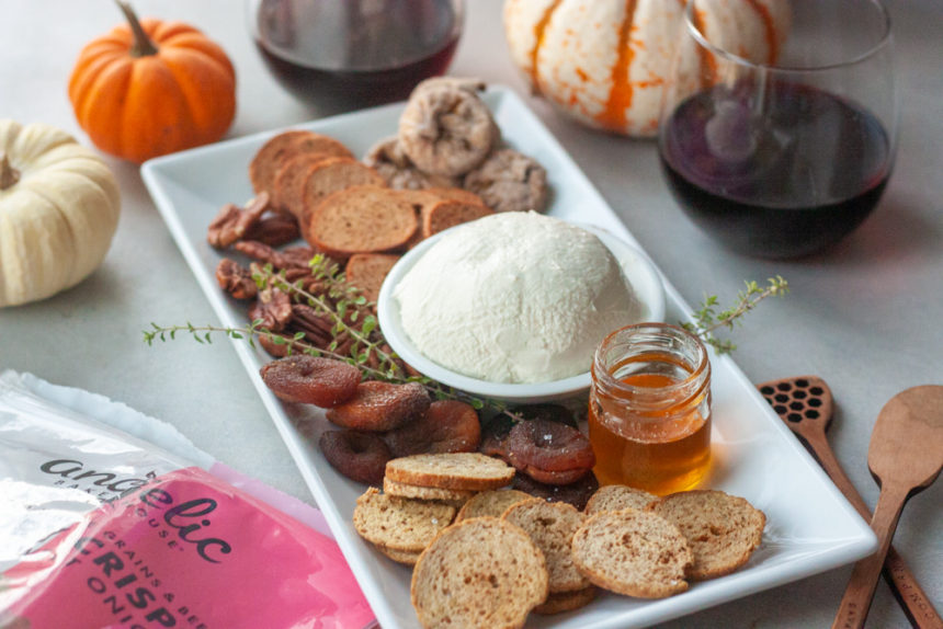 Charcuterie board, Angelic Bakehouse Sprouted Crisps, pumpkins, wine in 2 glasses, cheese, figs, honey