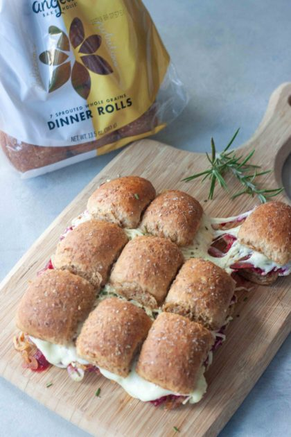 Pulling a Cranberry Grilled Cheese Sliders with melty cheese