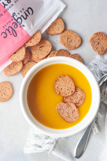 Golden Turmeric Butternut Squash Soup topped with Angelic Bakehouse Sprouted Pickled Sweet Onion Crisps