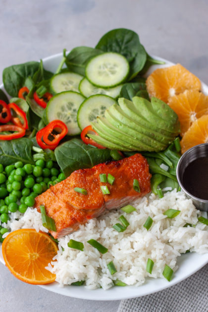 Orange Salmon Asian Veggie Bowls are one of the ways to customize my Asian Veggie Bowls adding salmon! Simple, anything but boring, delicious grain bowls that are packed with whole food flavor and easily customizable for the whole family. Easy to make, can be prepped ahead for a quick weeknight dinner.