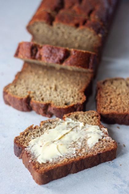 Life Is Bananas Blender Banana Bread Loaf sliced with butter