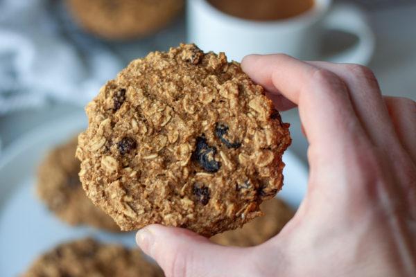 Hand holding a Oatmeal Raisin Breakfast Cookie