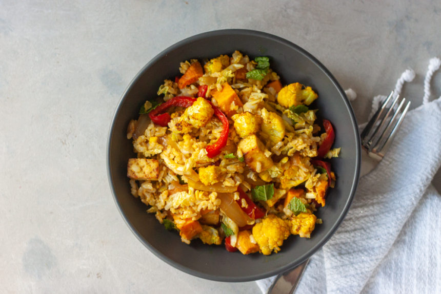 Flavor and nutrition packed gluten free and vegan Curry Cauliflower Grain Bowl 2.0 is meal prep friendly and great for lunch or dinner. Brown rice, roasted curry cauliflower, sauteed red pepper and onions, roasted sweet potatoes, optional crispy citrus tofu, fresh mint, and a Ginger Curry Dressing!