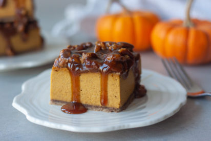 Pecan Pumpkin Pie Vegan Cheesecake Bars are a Thanksgiving must! Delicious creamy pumpkin cheesecake topped with caramel and pecans for a decadent gluten free, paleo, and vegan friendly.