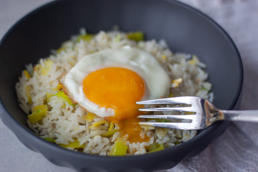 Ginger Garlic Fried Rice with egg in bowl with fork